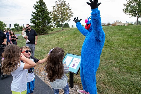 Cookie monster with Children at StoryWalk®