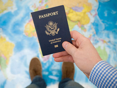 Hand holding a passport